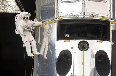 Hubble Space Telescope Views Photograph - Astronauts Working On The Hubble Space by Stocktrek Images