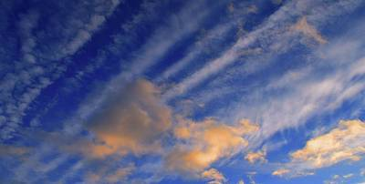 Photograph - Clouds At Sunset  by Lyle Crump