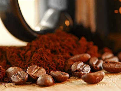 Still Life Royalty-Free and Rights-Managed Images - Coffee beans and ground coffee by Elena Elisseeva