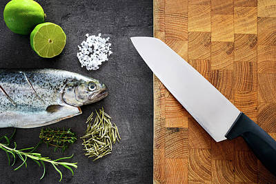 Photograph - Fresh Rainbow Trout With Lime And Seasoning. Fish At Dark Background. Detail Of Preparation by Marek Kijevsky