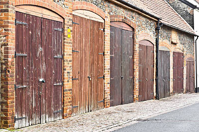 Old Brick Building Photograph - Garage Doors by Tom Gowanlock