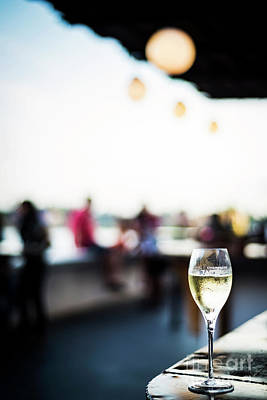 Photograph - Glass Of Champagne At Modern Outdoor Bar At Sunset by Jacek Malipan