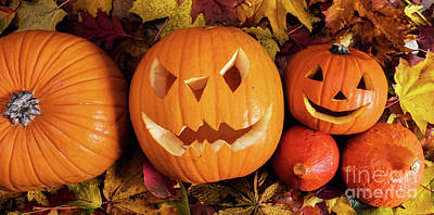 Creepy Photograph - Halloween Pumpkins, Carved Jack-o-lantern In Fall Leaves by Michal Bednarek