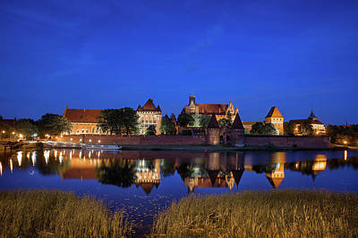 Photograph - Malbork Castle At Night In Poland by Artur Bogacki
