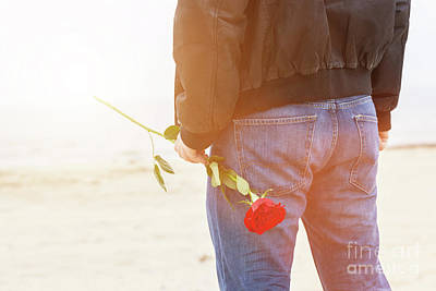 Photograph - Man With A Rose Behind His Back Waiting For Love. Romantic Date On The Beach by Michal Bednarek