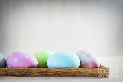 Photograph - Pastel Easter Eggs On Wooden Table. by Michal Bednarek