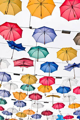 Umbrellas Art Print by Tom Gowanlock