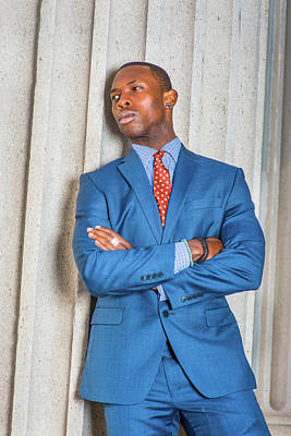 Photograph - Young African American Businessman Thinking Outside Office In Ne by Alexander Image