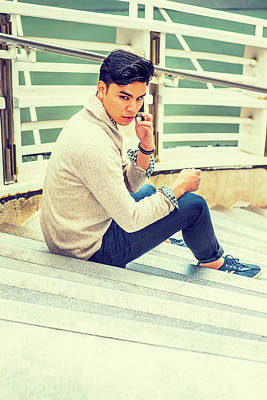 Photograph - Young Asian American Man Talking On Cell Phone Outside In New Yo by Alexander Image