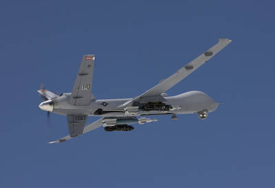 Photograph - An Mq-9 Reaper Flies A Training Mission by HIGH-G Productions