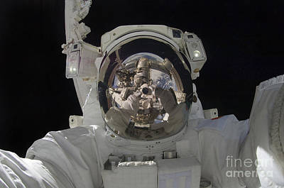 Self-portrait Photograph - Astronaut Uses A Digital Still Camera by Stocktrek Images