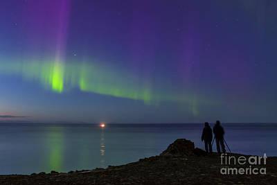 Aurora Borealis Over Iceland Shoreline Art Print by Babak Tafreshi
