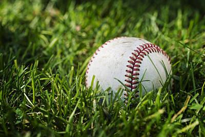 Baseball In Green Grass Art Print by Donald  Erickson