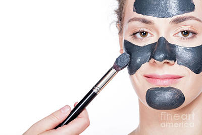 Aging Photograph - Black Charcoal Mask Application On Beautiful Woman. by Michal Bednarek