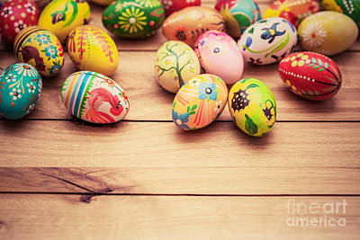Symbol Photograph - Colorful Hand Painted Easter Eggs On Wood by Michal Bednarek