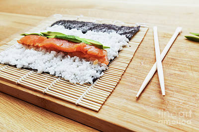 Eat Photograph - Preparing Sushi. Salmon, Avocado, Rice And Chopsticks On Wooden Table by Michal Bednarek