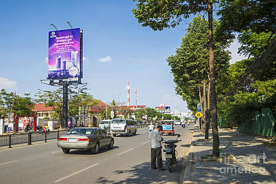 Mellow Yellow Rights Managed Images - Street In Central Phnom Penh City Cambodia Royalty-Free Image by JM Travel Photography
