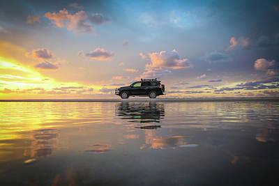 4wd Vehicle And Stunning Sunset Reflections On Beach Art Print