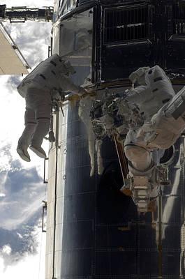 Hubble Space Telescope Views Photograph - Astronauts Participate by Stocktrek Images