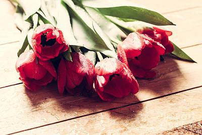 Elegant Photograph - Fresh Red Tulip Flowers Bouquet On Wood by Michal Bednarek
