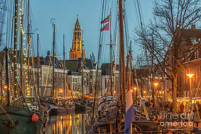Vermeer Rights Managed Images - Groningen at night with boats and lights Royalty-Free Image by Patricia Hofmeester