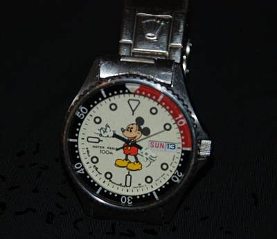 Photograph - Mickey Mouse Watch by Rob Hans