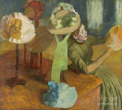 Worker Painting - The Millinery Shop by Edgar Degas