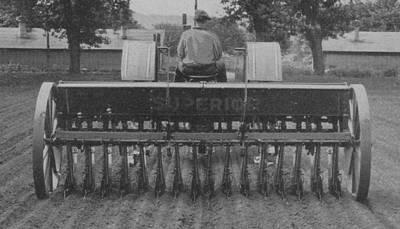 A Farmer Driving A Tractor Art Print by American School