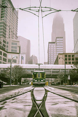 Photograph - Streetcar Waiting For Passengers In Snowstrom In Uptown Charlott by Alex Grichenko