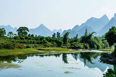Photograph - The Karst Mountains And River Scenery by Carl Ning