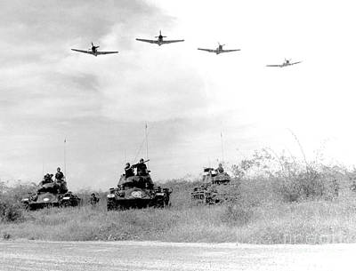Armored Vehicle Photograph - A-1h Aircraft Make A Low Level Pass by Stocktrek Images