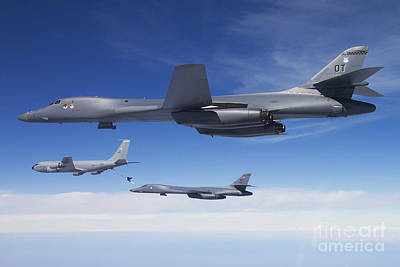 A B-1b Lancer Stands By As Another Art Print by Stocktrek Images