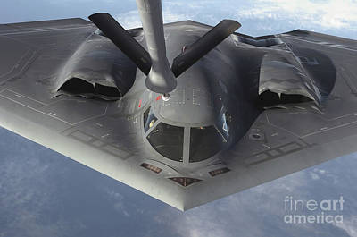 Stratotanker Photograph - A B-2 Spirit Bomber Prepares To Refuel by Stocktrek Images