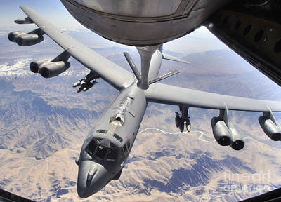 Stratotanker Photograph - A B-52 Stratofortress Receives Fuel by Stocktrek Images