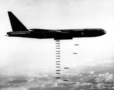 A B-52 Stratofortress Releases Bombs Print by Everett