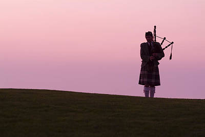 Bagpipes Wall Art - Photograph - A Bagpiper On A Golf Course by Richard Nowitz