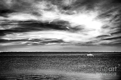 Photograph - A Boat In The Bay by John Rizzuto