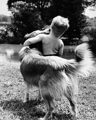 Photograph - A Boy And His Dog, C. 1950s by H Armstrong Roberts ClassicStock