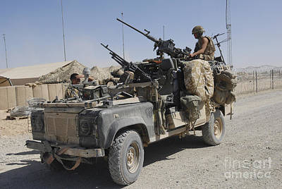 Foreign Military Photograph - A British Armed Forces Land Rover by Andrew Chittock