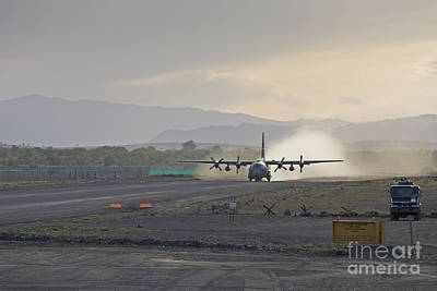 C-130 Wall Art - Photograph - A C-130 Taking Off by Tim Grams