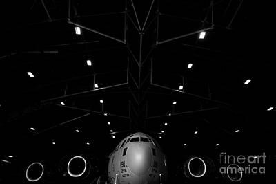 A C-17 Globemaster IIi Sits In A Hangar Art Print