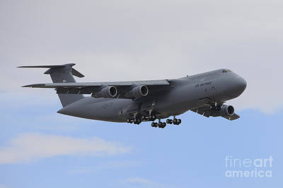 Photograph - A C-5 Galaxy In Flight Over Nevada by Remo Guidi