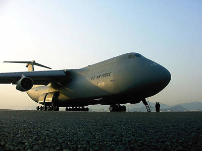 A C-5 Galaxy Sits On The Flightline Print by Stocktrek Images