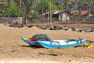 Photograph - A Catamaran Is Laying On The Beach Of The Indian Ocean On The Tropical Island Sri Lanka by Regina Koch