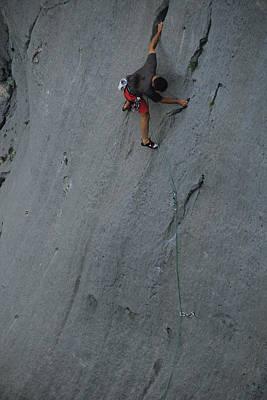 A Caucasian Man Rock Climbing Art Print by Bobby Model