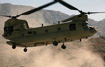 Operation Enduring Freedom Photograph - A Ch-47 Chinook Helicopter Kicks by Stocktrek Images