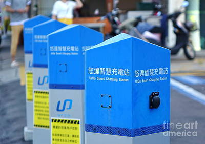 Photograph - A Charging Station For Electric Vehicles by Yali Shi
