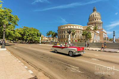 Street Photograph - A Classic Taxi Car Cruises The Streets Of Havana by Viktor Birkus