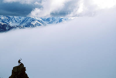 Raised Image Photograph - A Climber On The Summit In Denali by John Burcham