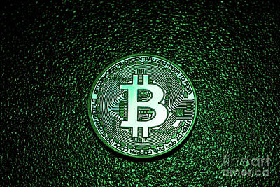 Photograph - A Coin With Bitcoin Logo In A Green Lighting. by Michal Bednarek